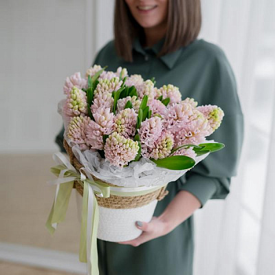 Monobouquet of hyacinths in a basket
